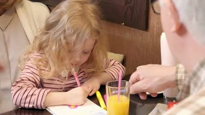 Little Girl Drawing with Grandparents
