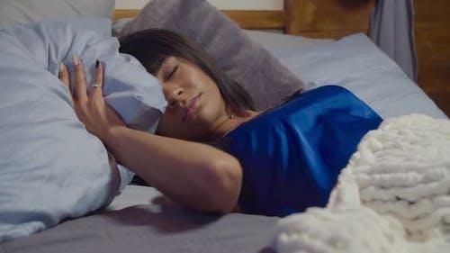 Pretty Mixed Race Female Suffering Sleep Disorder