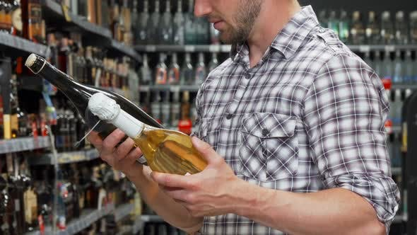 Thumbnail for Man Choosing Between Two Bottles of Wine