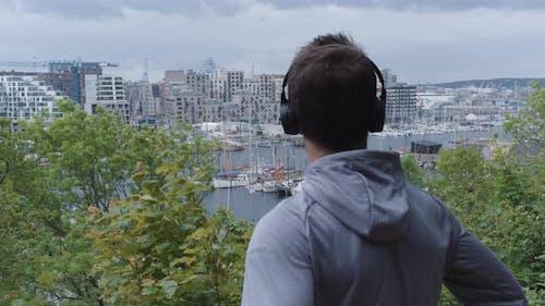 Athlete In Headphones And Hoody Looking At View