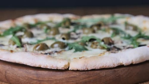 Appetizing Pizza on a Wooden Table in a Restaurant