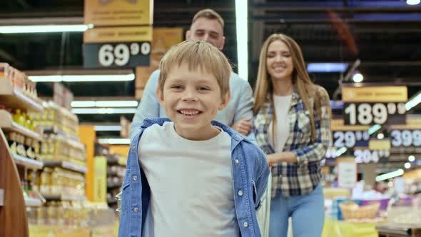 Thumbnail for Happy Kid Enjoying Shopping with Parents