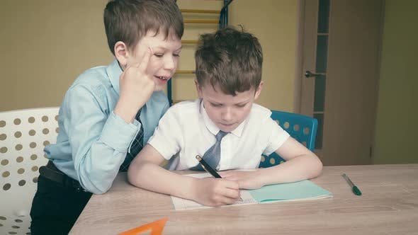 Thumbnail for Pupils Do Homework, Write Numbers in Notebooks, Help Each Other, on the Tables Are School Things.