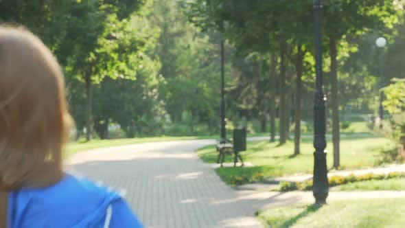 Thumbnail for Beautiful Happy Sportswoman Smiling To the Camera While Running in the Park