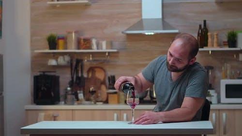 Sad Man Pouring Wine