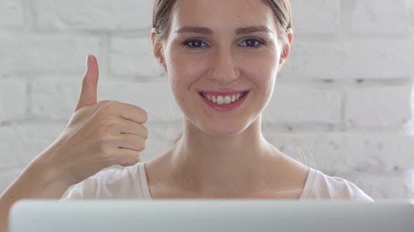 Thumbnail for Thumbs Up by Woman in Loft Office