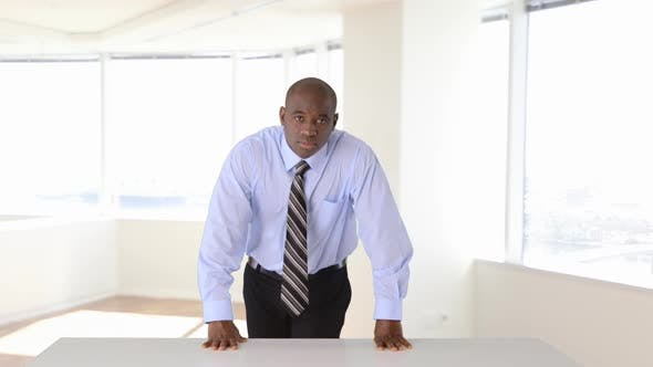 Thumbnail for Confident African American businessman standing with arms crossed