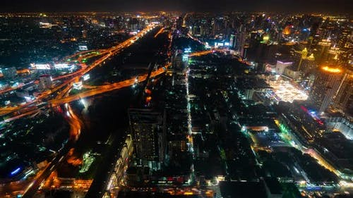 time lapse of Bangkok city downtown and expressway road traffic at night of Thailand , Cityscape