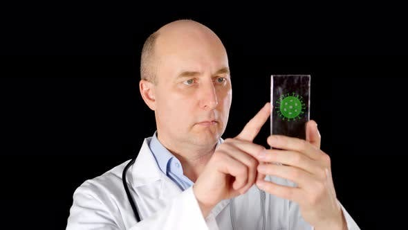 Male Doctor Looking on Transparent Screen Microbe Molecules. Medical Worker Swiping Mobile Screen