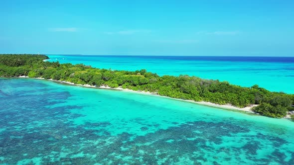 Thumbnail for Wide angle above copy space shot of a paradise sunny white sand beach and aqua blue water background