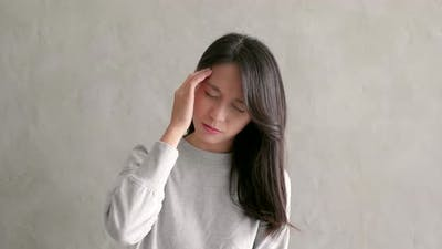 Asian woman feeling headache