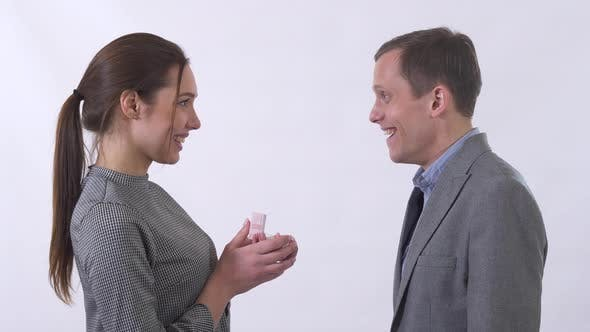 Thumbnail for Beautiful Young Woman Open a Present Box To a Man and Show Guy Her Present