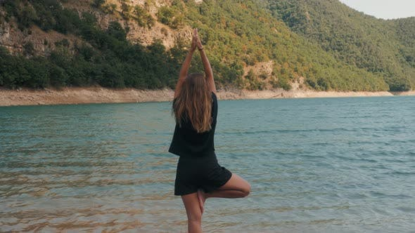 Thumbnail for Young Woman Tourist Practicing Yoga in the Nature, Female Happiness, Caucasian Woman Is Practicing