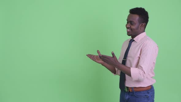 Thumbnail for Happy Young African Businessman Showing Something