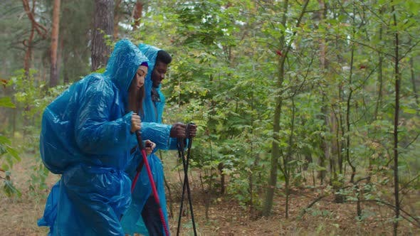 Thumbnail for Hiking Couple in Raincoats Backpacking in Nature