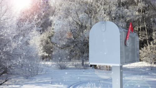 Mailbox with a Christmas Greeting Card on the Background of a Winter Forest