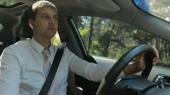 Thumbnail for Man Using Hands Free Device To Make a Call in Car
