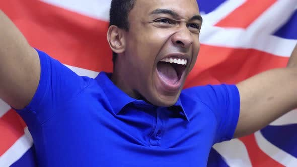 British Fan Celebrating while Holding the British Flag
