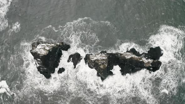 Thumbnail for Aerial View of Black Sand Beach in Cloudy Weather, The Beginning of Spring in Iceland