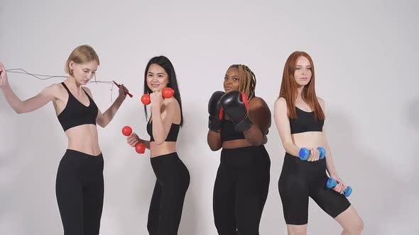 Confident Fitness Women of Differnet Nationalities Posing at Camera