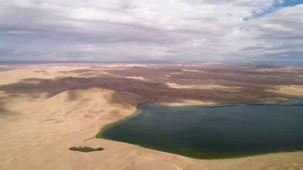 Thumbnail for Panoramic View From Above on a Sandy Desert with Lakes.