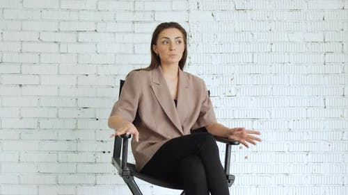 the actress is sitting on a chair, there are auditions for the film