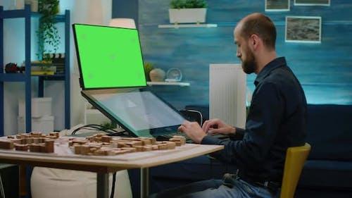 Man Architect Looking at Horizontal Green Screen