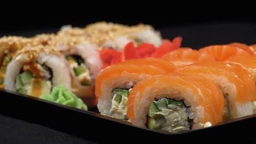 Sushi Rotates on Plastic Box. Japanese Sushi Roll Set Philadelphia, California