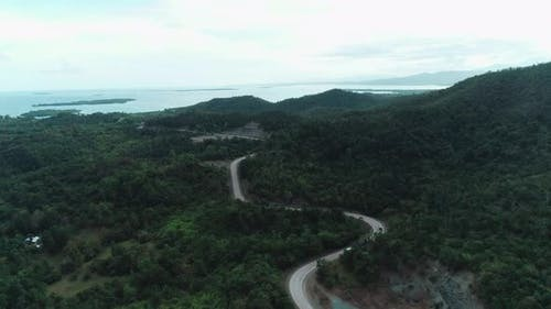 Aerial View of Countryside Road Passing Through the Lush Greenery and Foliage Tropical Rain Forest