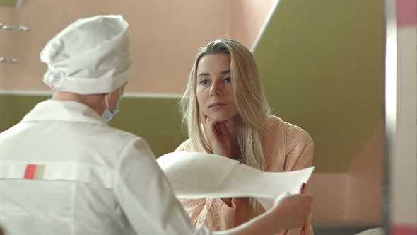 Thumbnail for Young Female Doctor with Female Patient Talking in Hospital Room