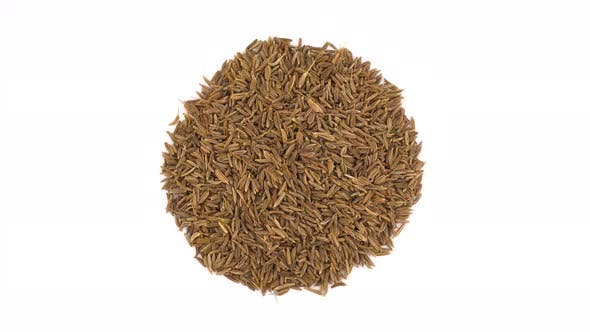 Thumbnail for Top View From Above of a Circle Shaped Caraway Seeds Heap. Rotating on the Turntable. Isolated on