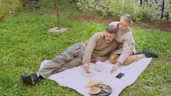 Thumbnail for A Husband and Wife Had a Picnic in the Family Garden Near Their Own Village House. They Drink Tea