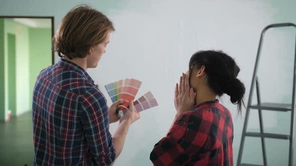 Thumbnail for Couple in New Home Choosing Wall Paint Colors