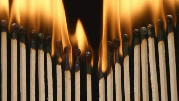 Thumbnail for Row of burning matchsticks