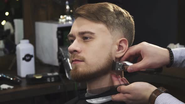 Thumbnail for Young Man Getting His Beard Trimmed By a Professional Barber