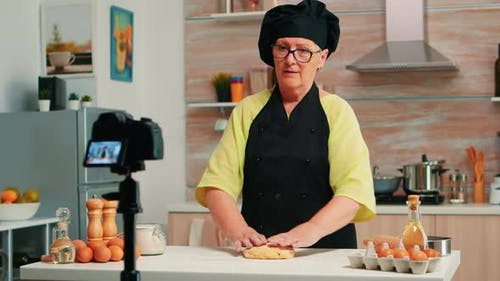 Senior Woman Creating Content for Culinary Blog