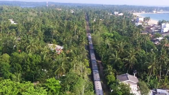 Thumbnail for Slow Motion Aerial Shot the Old Train Rides Through the Tropics