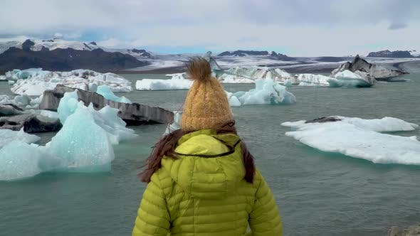 Thumbnail for Tourist on Iceland Looking at Jokulsarlon Glacier Lagoon