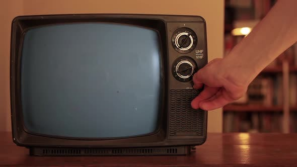 Thumbnail for Male Hand turning on a Retro TV with Green Screen.