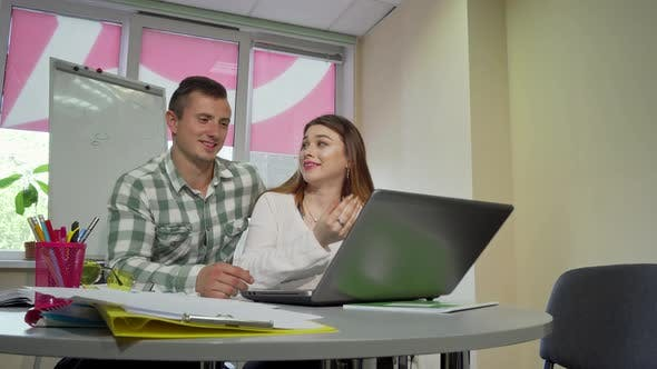 Thumbnail for Cheerful College Couple Studying Together, Using Laptop