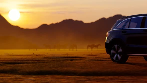 Thumbnail for Horses and Black Luxury Off-Road Vehicle in Mountainous Area with Sunset View