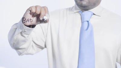 Asian Businessman Writes Bad Debt