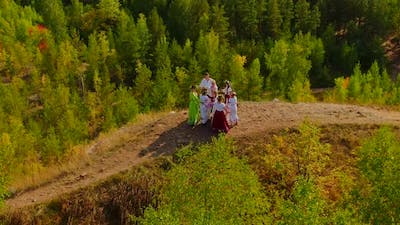 Aerial View People in Folk Costumes Lead a Round Dance Beautiful Outfits with Embroidery and Flower