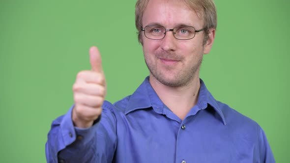 Thumbnail for Head Shot of Happy Handsome Blonde Businessman Giving Thumbs Up