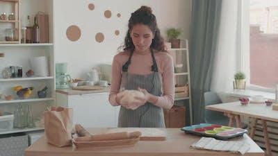 Female Influencer Kneading Dough on Camera