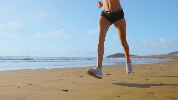 Thumbnail for Beautiful Woman in Sports Shorts and T-shirt Running on the Beach with White Sand and Blue Ocean