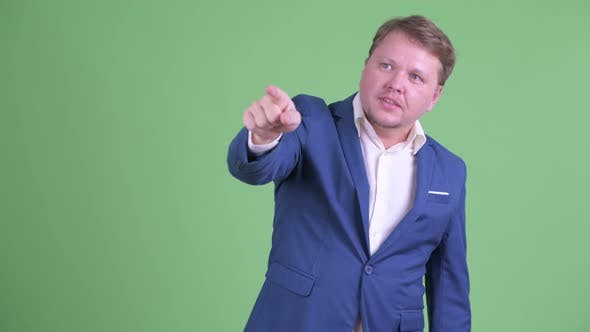 Thumbnail for Happy Overweight Bearded Businessman Pointing Finger