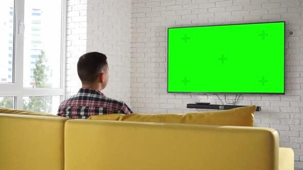 Man Watches Tv Set Green Screen
