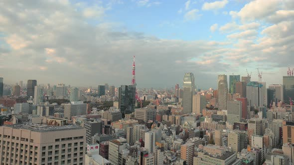 Thumbnail for Tokyo, Japan circa-2018.  Time lapse shot of clouds moving over city of Tokyo and Tokyo Tower at sun
