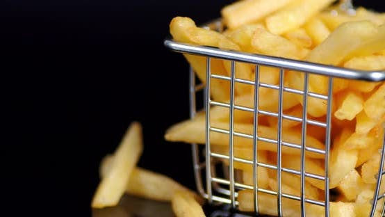 French Fries in Basket Slowly Rotates.